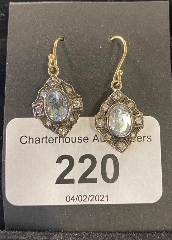 A pair of modern yellow coloured metal topaz drop earrings Report by JS Note: this is 20th/21st