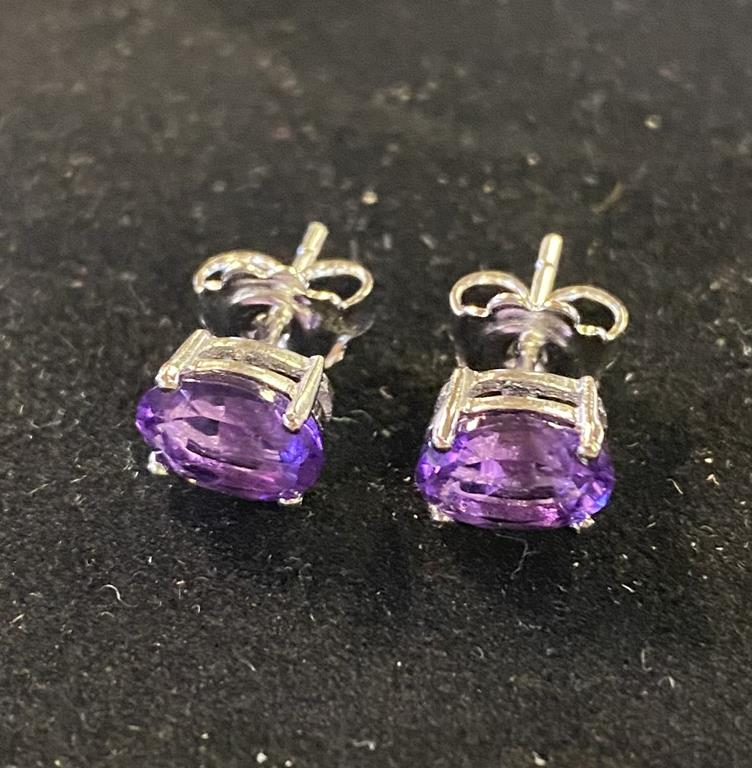 A pair of oval amethyst stud earrings, set in silver