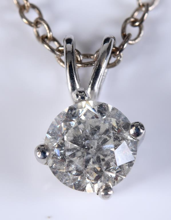 A 14ct white gold and diamond single stone pendant, approx. 1.00ct, on a chain