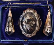 A pair of late Victorian inlaid tortoisehell pendant earrings and a matching brooch, in a later box