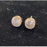 A pair of stud earrings