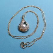 A modern yellow and silver coloured metal pearl and diamond pendant on yellow metal chain Report