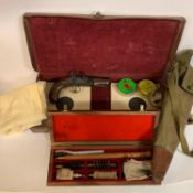An early 19th century flintlock pistol, Archer, 20 cm, a leather case, and a set of cleaning