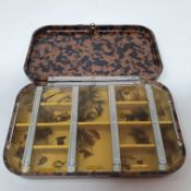 A bakelite fly box, possibly a Hardy's Neroda, 16 cm wide 16 cm wide x 10 cm deep x 2.5 cm high,
