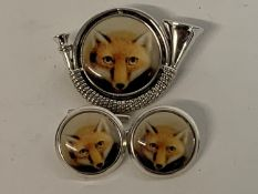 A pair of silver fox enamel cufflinks, and a horn brooch