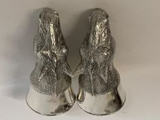 A pair of white coloured metal horse salt and pepper pots Modern