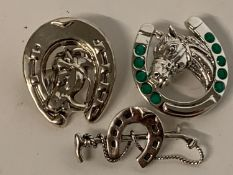 Three silver horseshoe/hunt brooches Modern