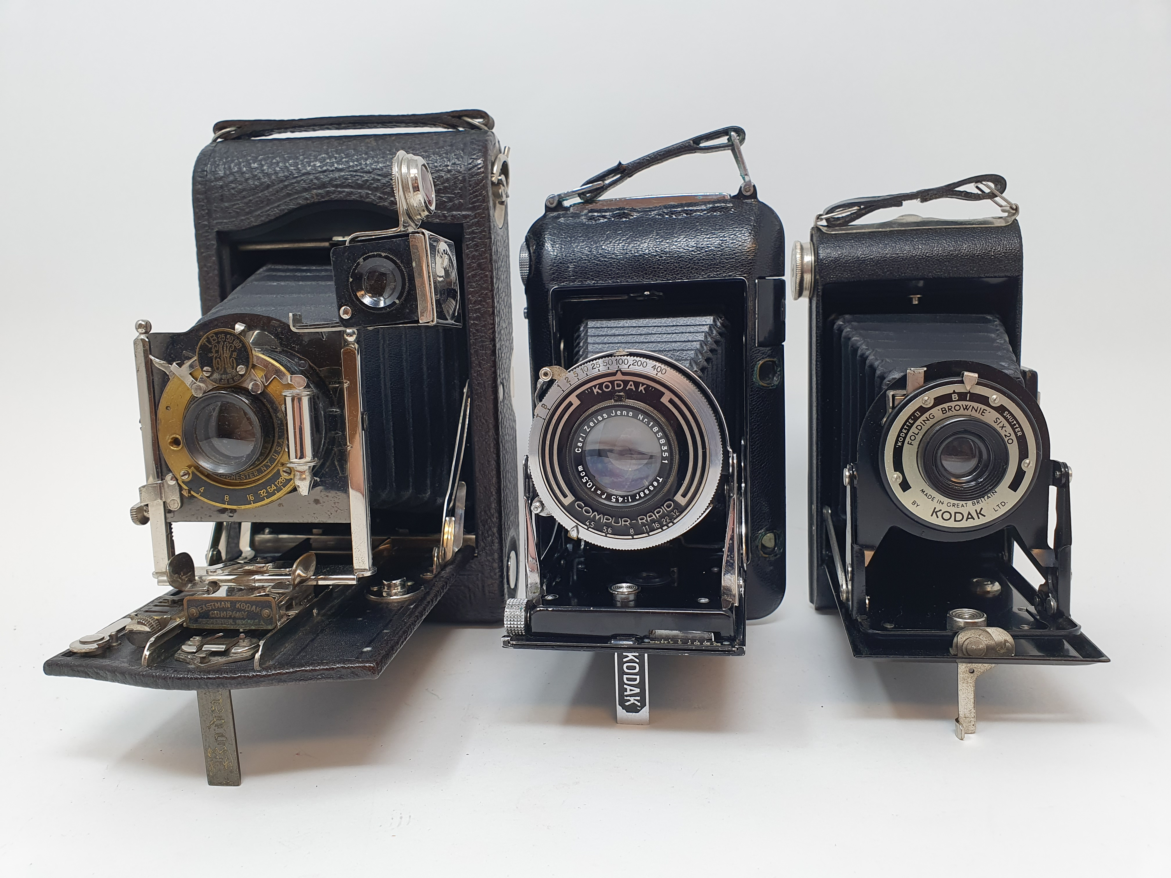 A Kodak Regent folding camera, with leather outer case, a Kodak folding camera, with leather outer