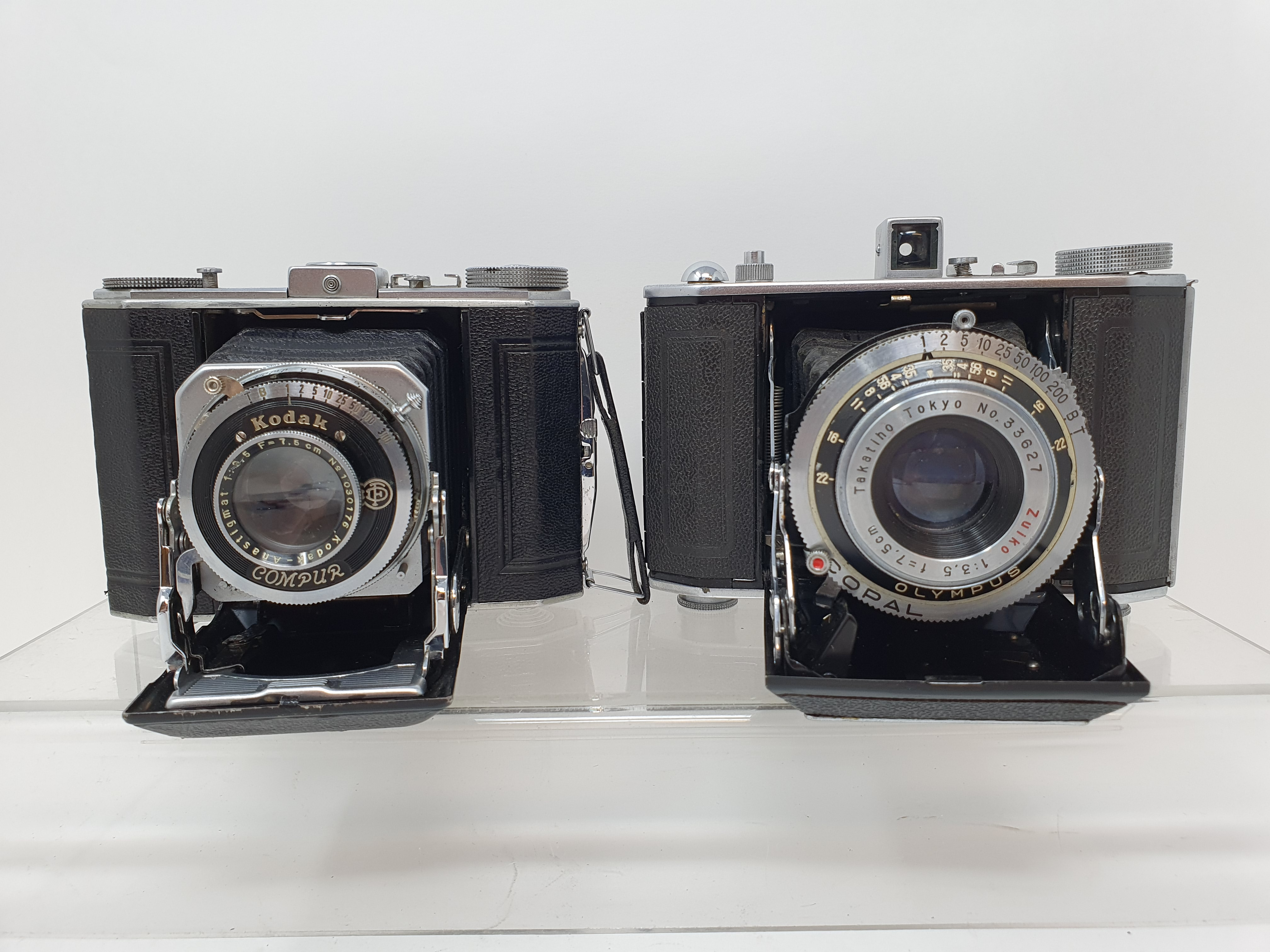 An Olympus-Six folding camera, serial number 21128 and a Duo 620 folding camera (2) Provenance: Part