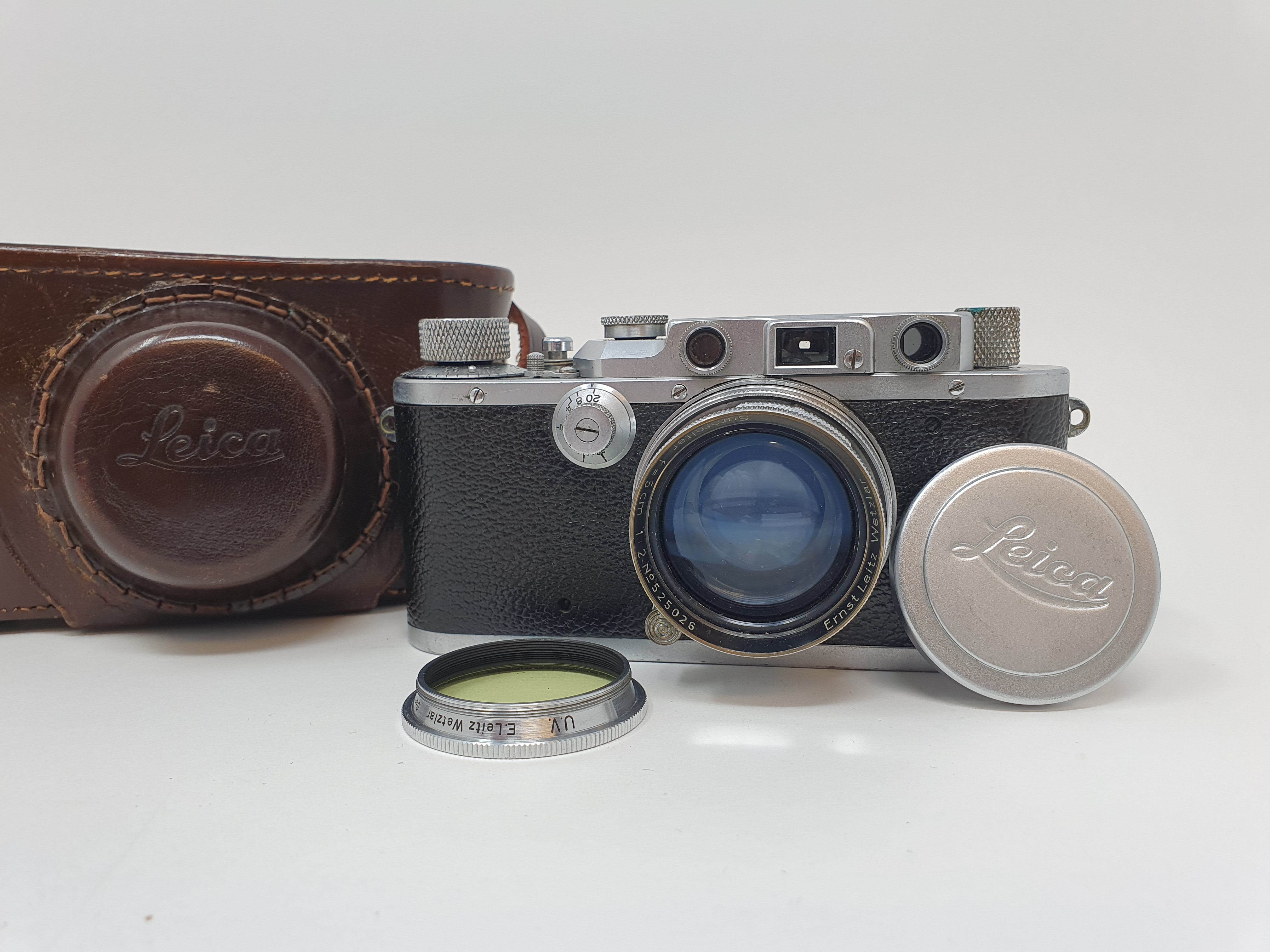 A Leica IIIa camera, serial number 324178, with leather outer case Provenance: Part of a vast single