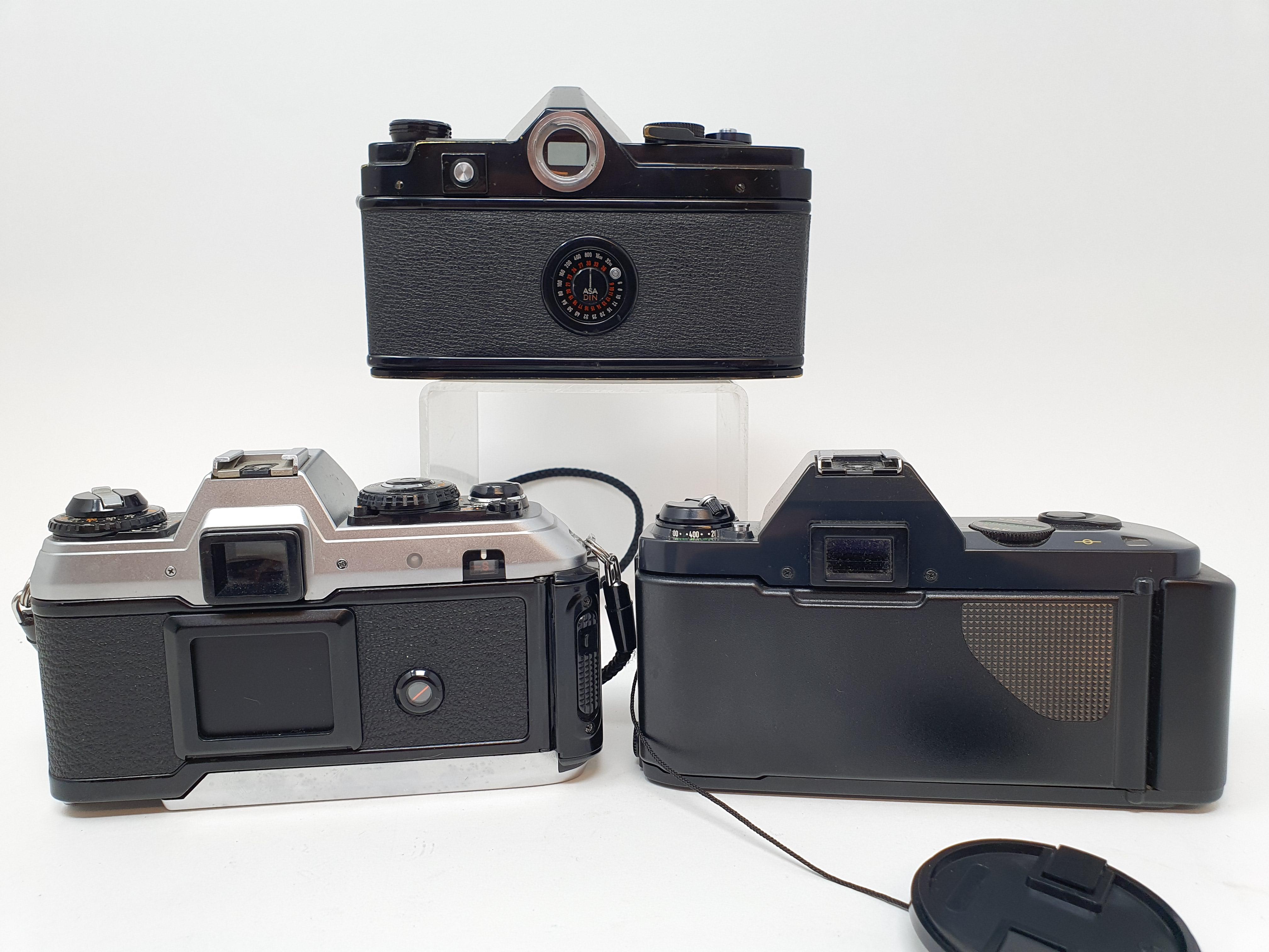 A Minolta SR-7 camera, a Canon T50 camera and a Konica FT-1 camera (3) Provenance: Part of a vast - Image 3 of 3