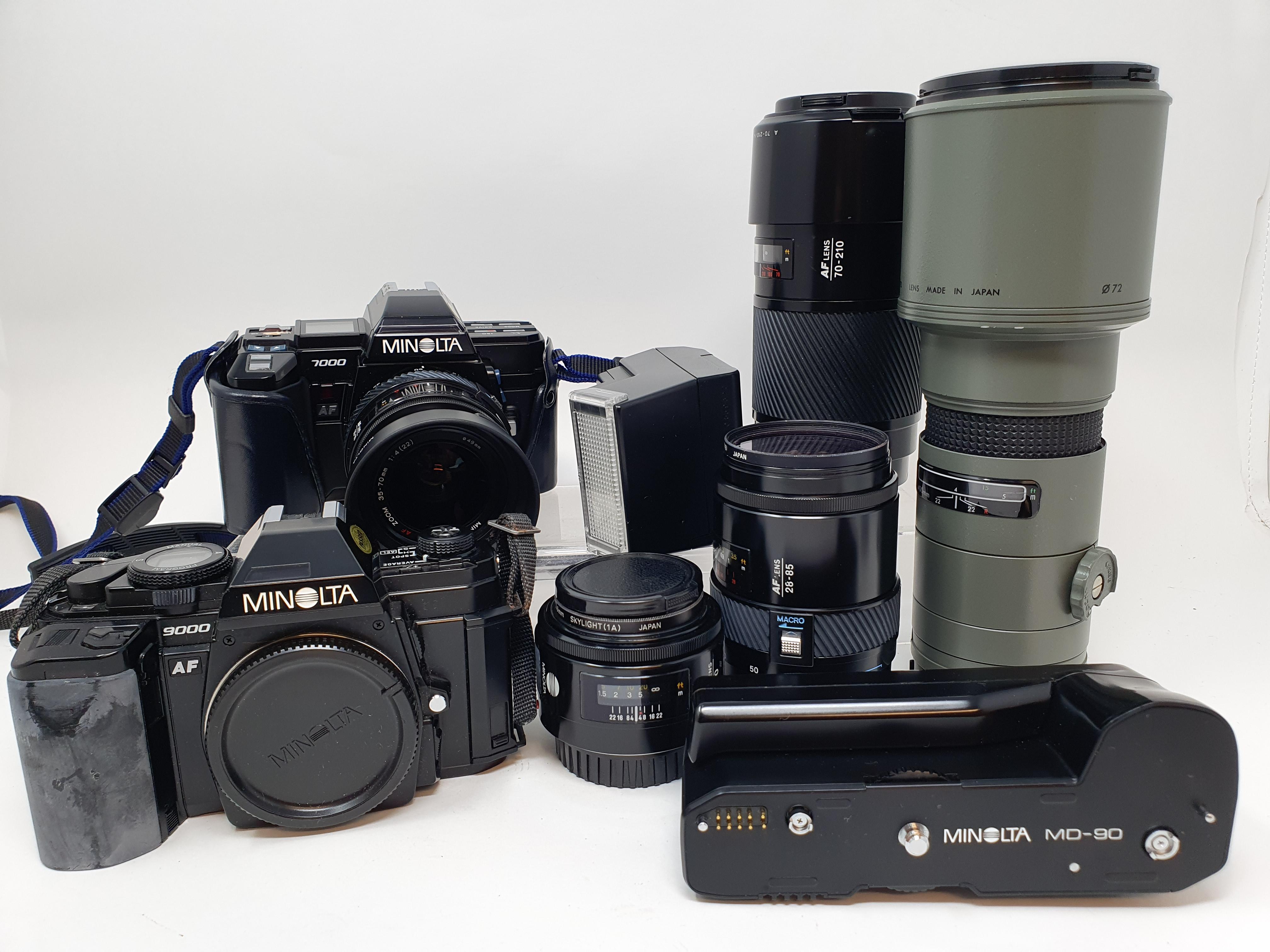 A Minolta 9000 camera, a Minolta 7000 camera, various lenses and accessories in a carrying case