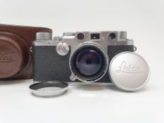 A Leica IIIf camera, serial number 537112, with leather outer case Provenance: Part of a vast single