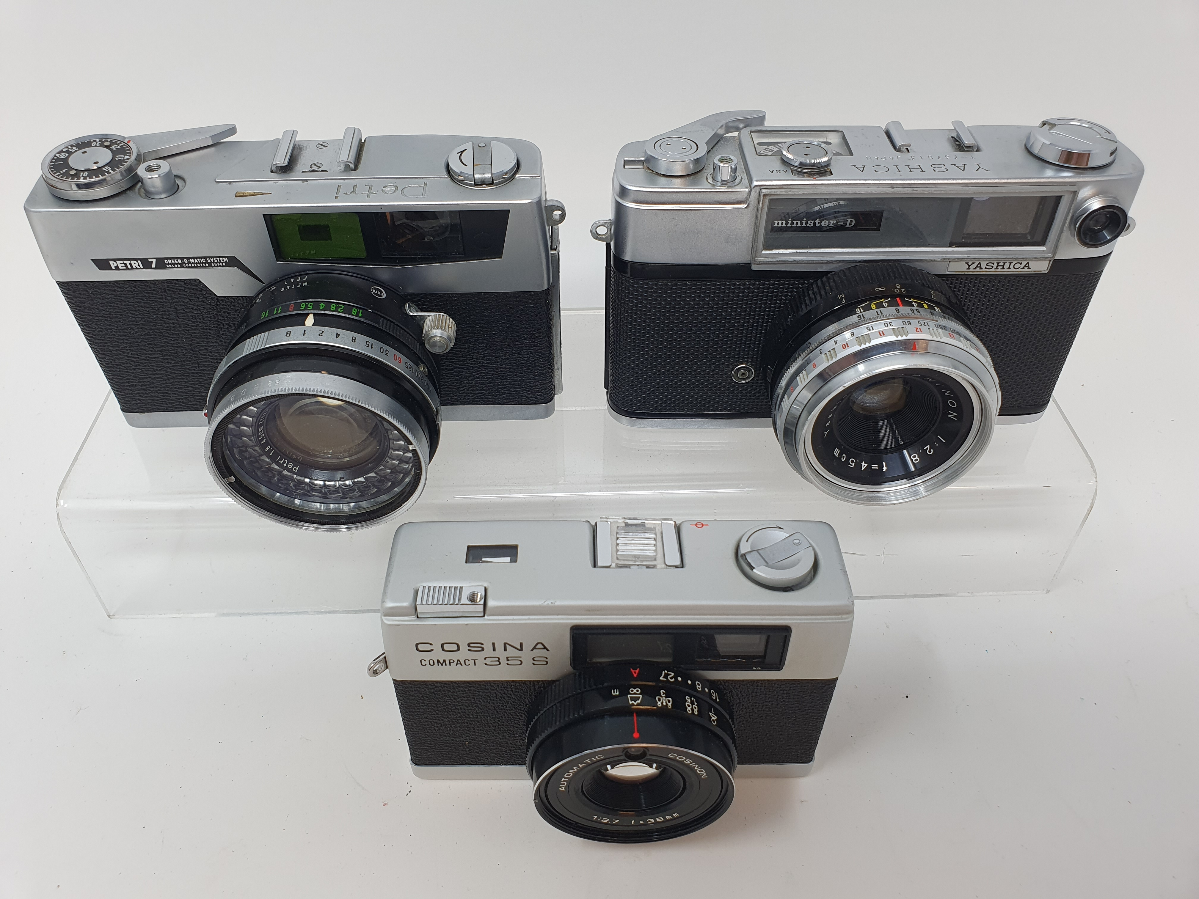 A Cosina compact 35S camera, a Yashica camera, serial number T-737513, and a Pretri 7 camera (3) - Image 2 of 2