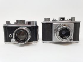 An Olympus 35 camera, serial number 28481, with outer leather case, and a Robot camera, with outer