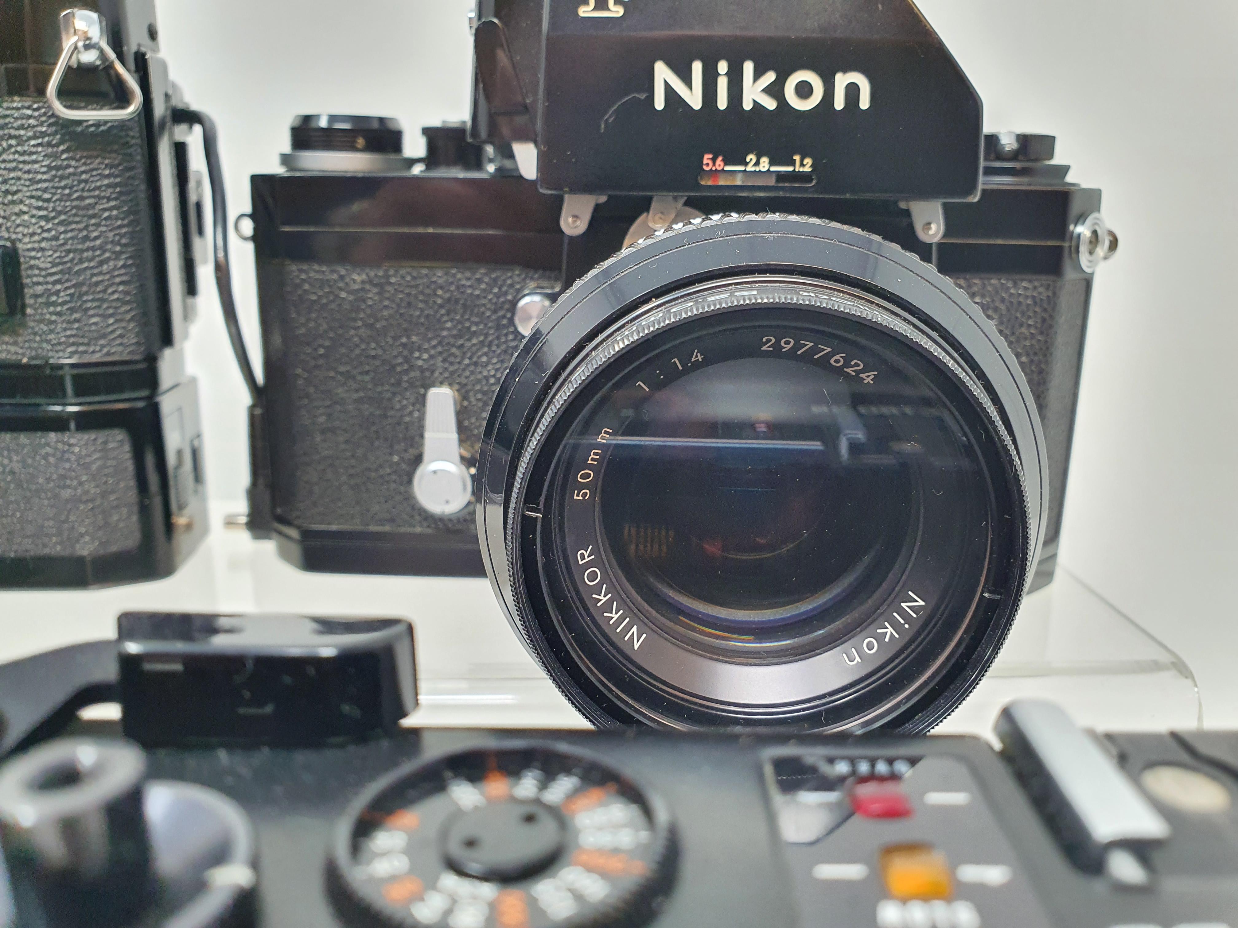 A Nikon F camera, with outer case, a Yashica GTN camera, a Canon A-1 camera, and a Nikkormat Nikon - Image 4 of 6