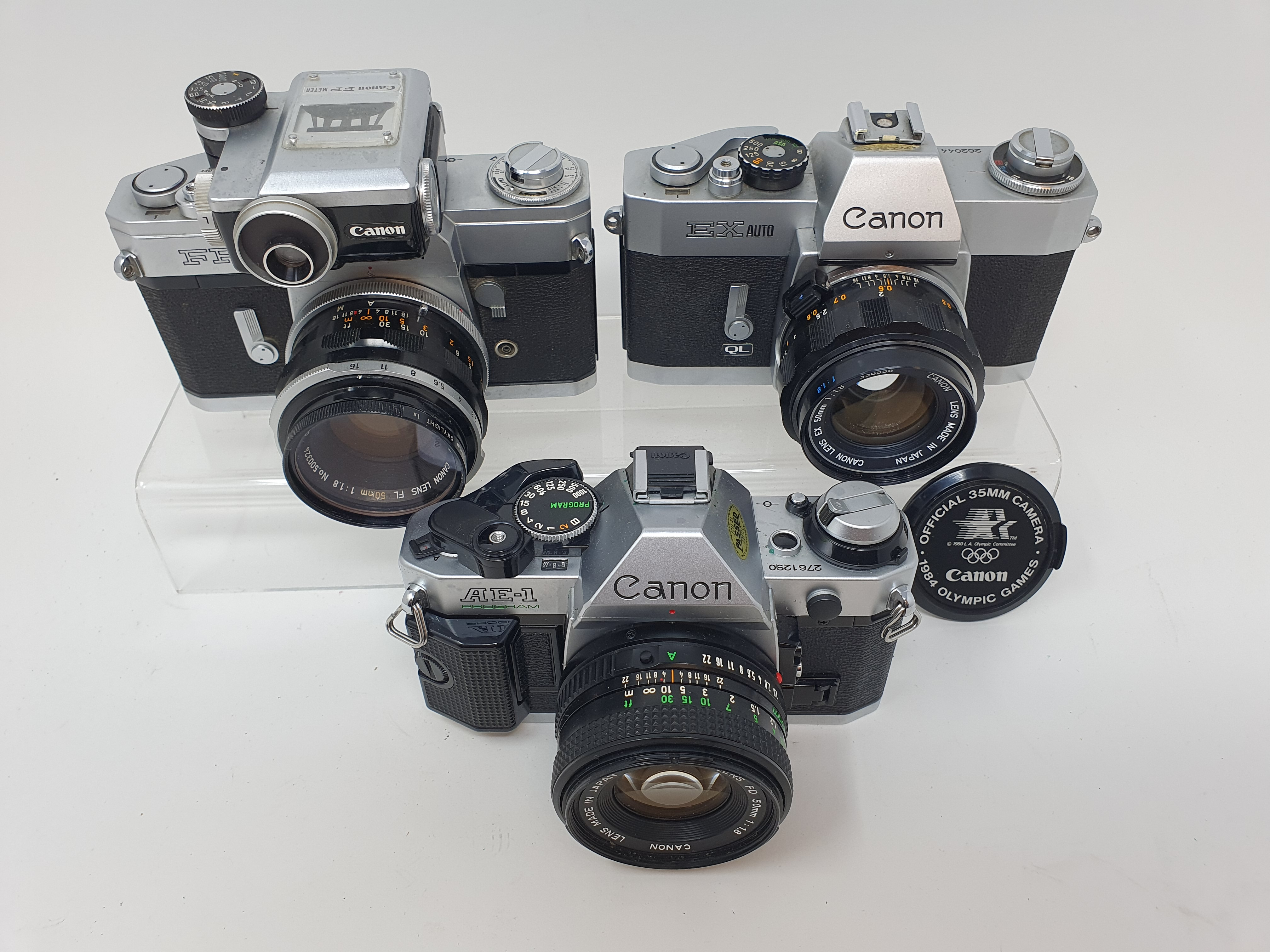 A Canon FP camera, a Canon EX Auto, and a Canon AE-1 camera (3) Provenance: Part of a vast single - Image 3 of 3