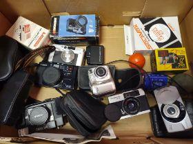 A Canon Z70w camera, a Konica camera, a Nikon Cooldix 3100 camera, a Canon AF35M camera, a