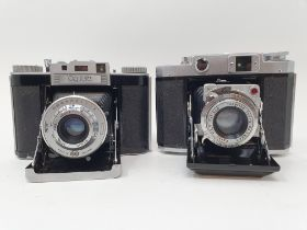 A Mamiya-6 folding camera, with leather outer case, and an Agiwx Agifold folding camera, with