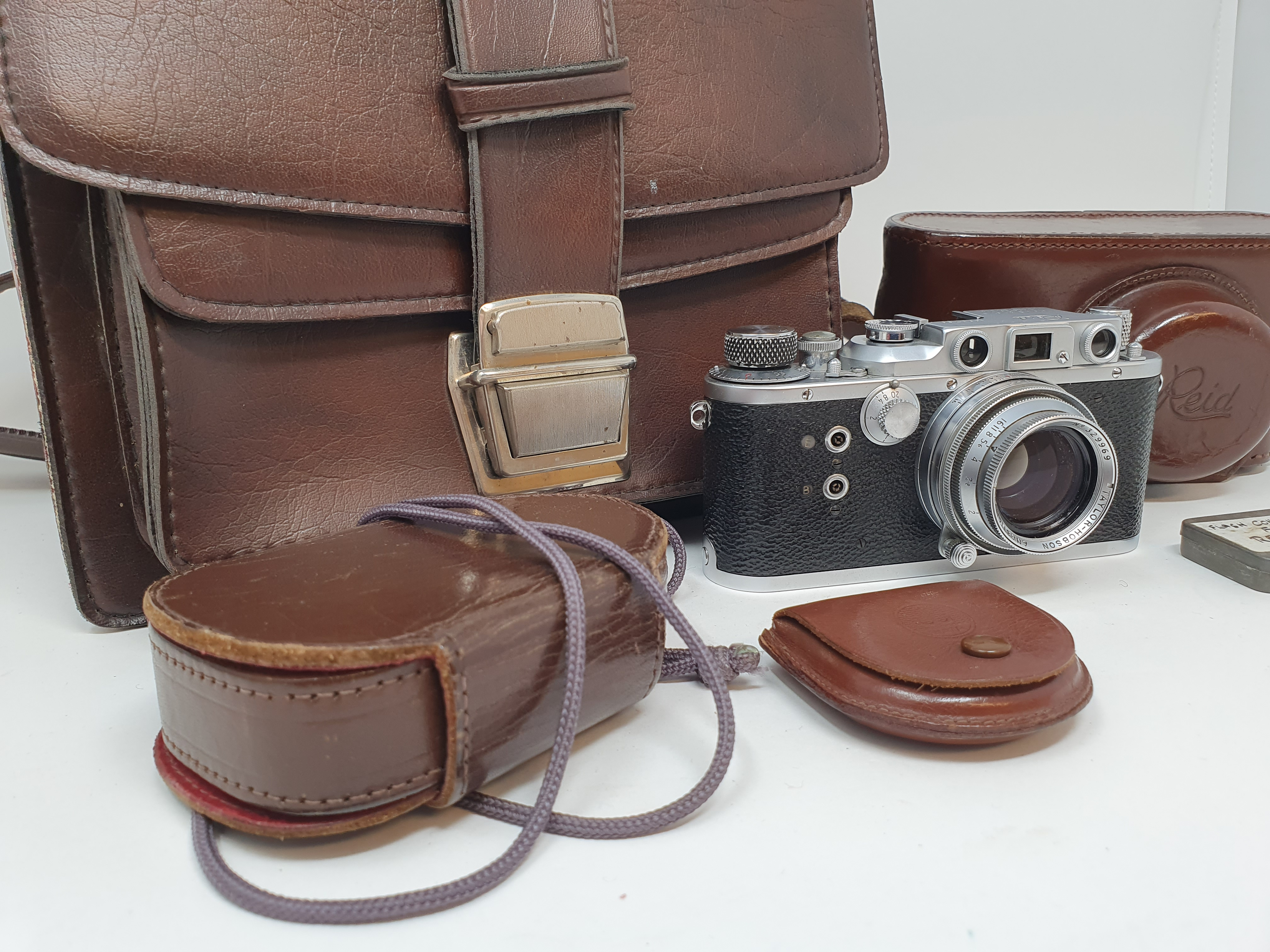 A Reid & Sigrist ltd camera, serial number P2750, with leather outer case, lens, and accessories - Image 2 of 7