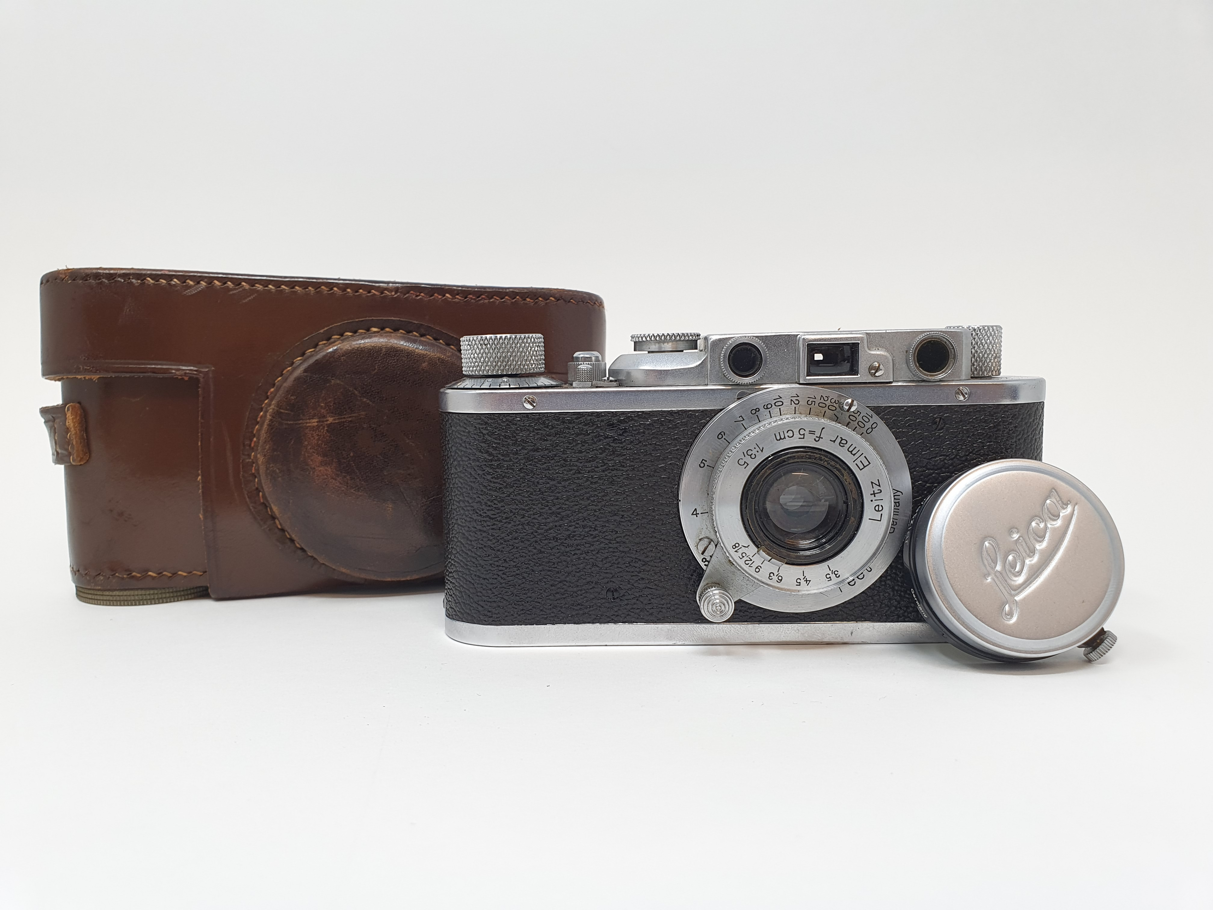 A Leica II camera, serial number 108206, with leather outer case Provenance: Part of a vast single
