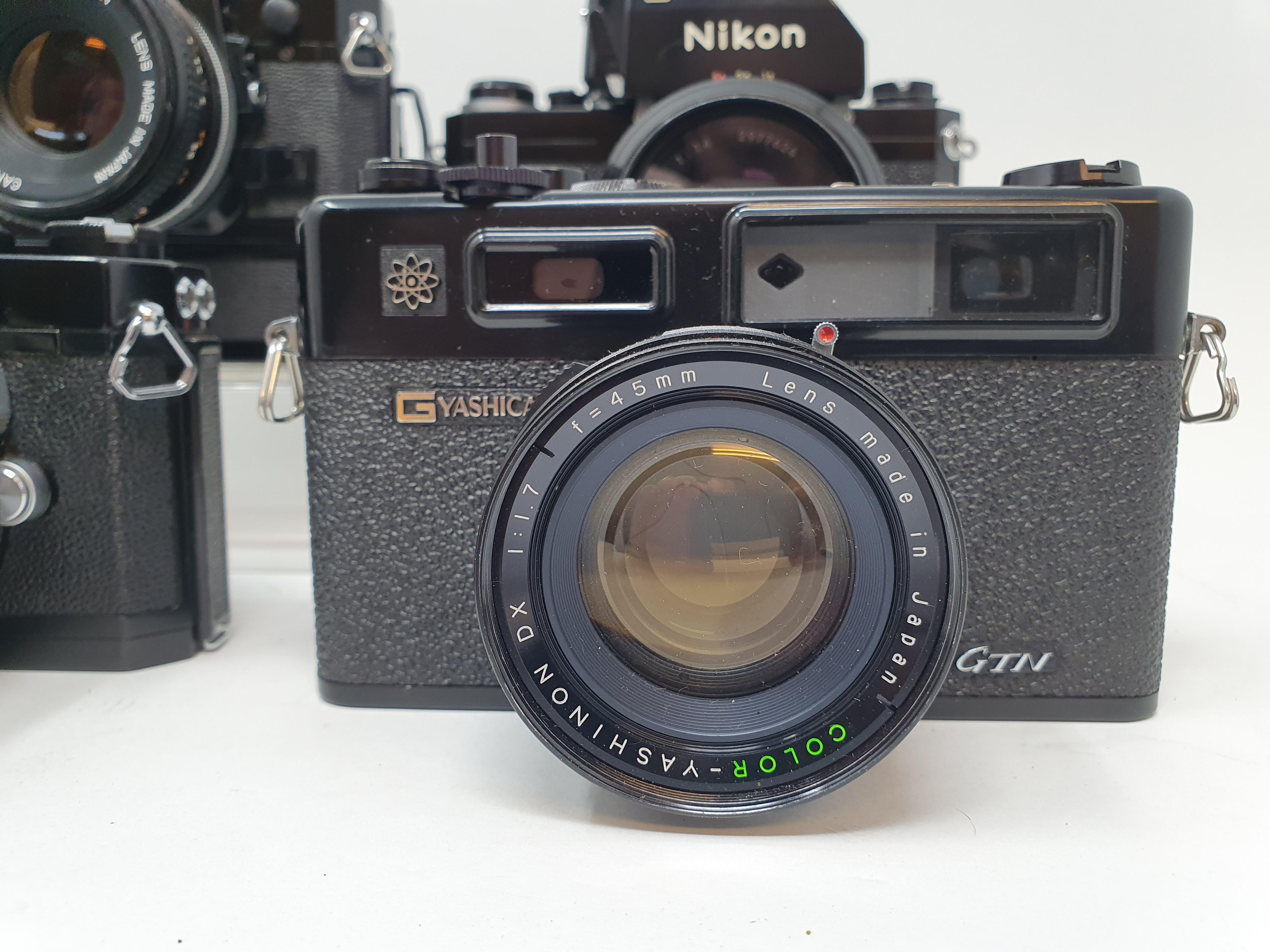 A Nikon F camera, with outer case, a Yashica GTN camera, a Canon A-1 camera, and a Nikkormat Nikon - Image 3 of 6