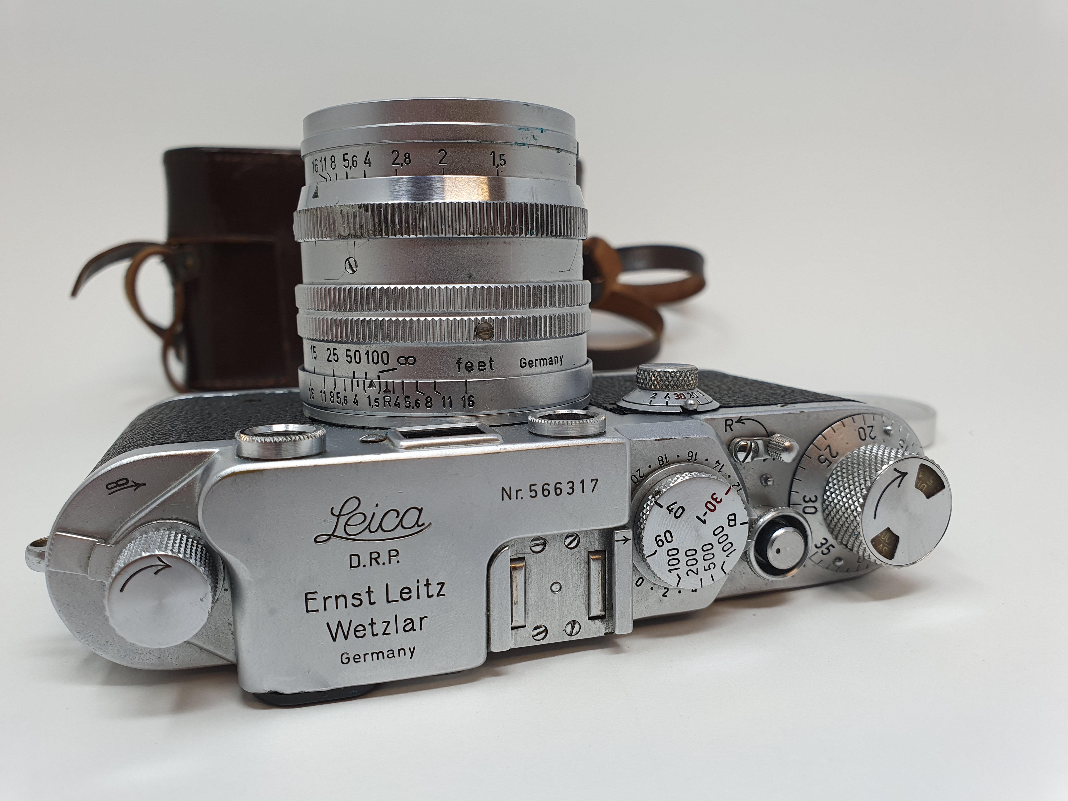 A Leica IIIf camera, serial number 566317, with leather outer case Provenance: Part of a vast single - Image 2 of 4