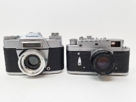 A Voigtlander Bessamatic camera and a Russian Zorki-4 camera, with leather outer case Provenance: