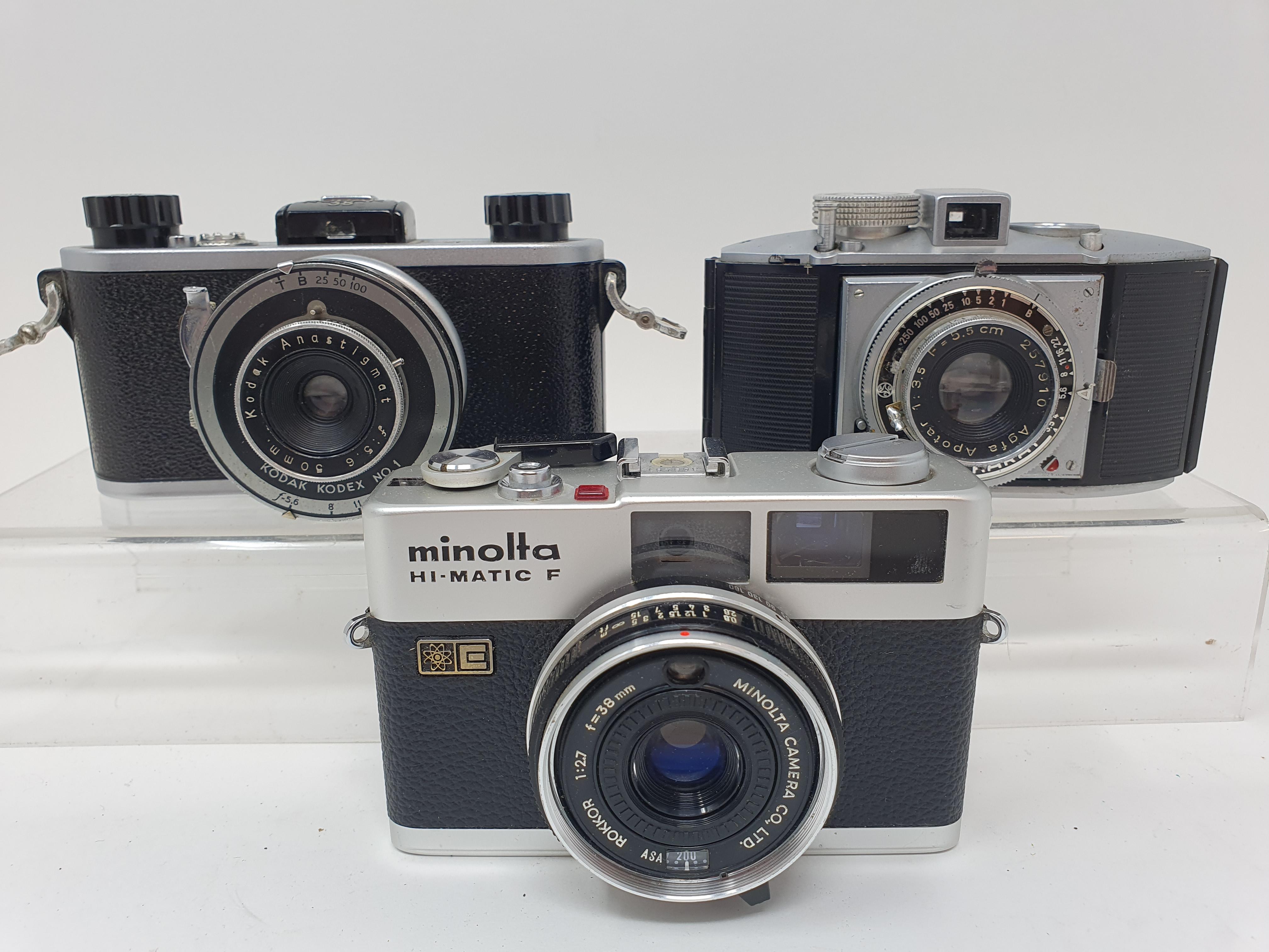 A Kodak 35 camera, a Minolta Hi - Matic F camera, and an Agfa Karat camera (3) Provenance: Part of a