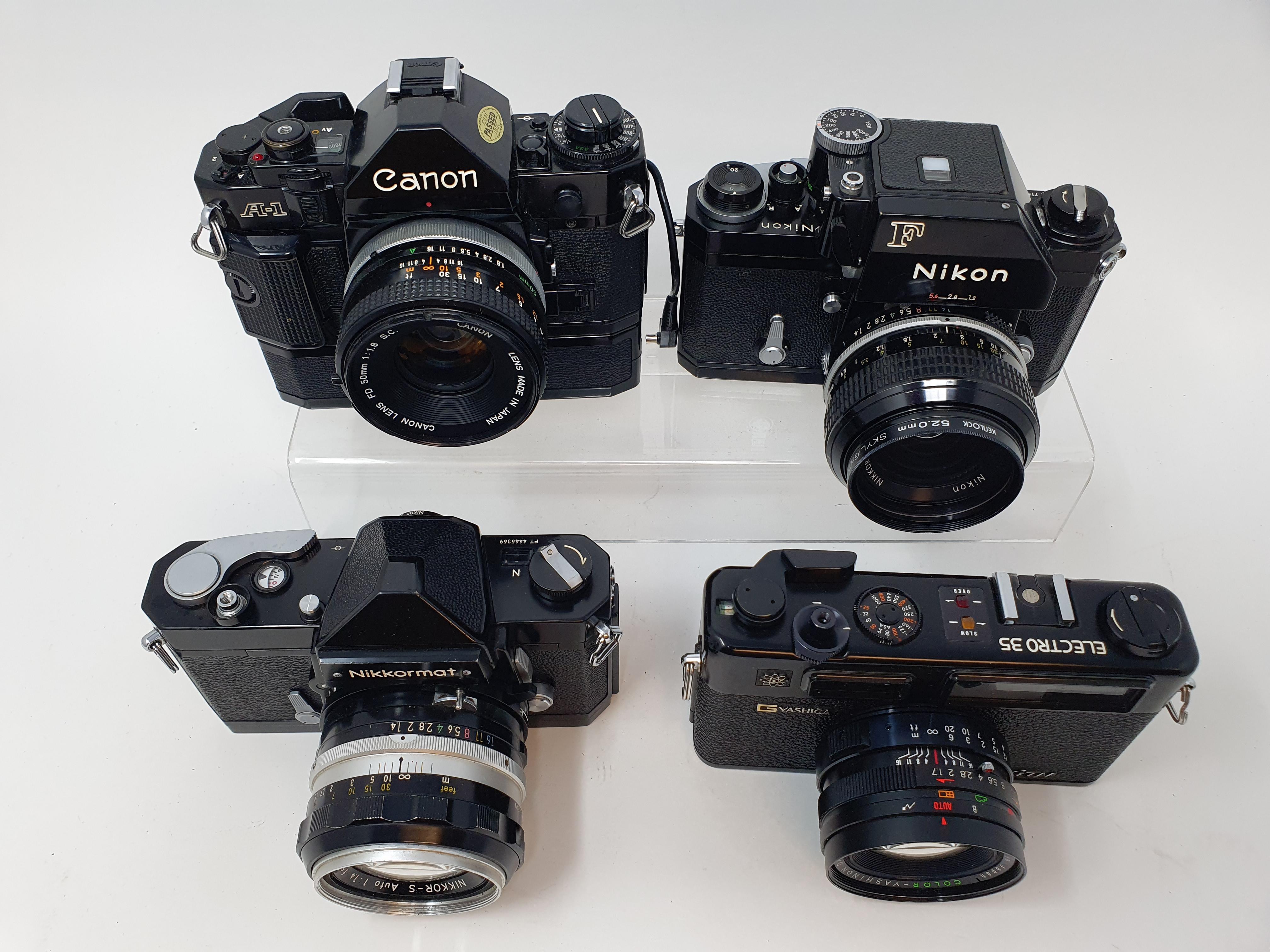 A Nikon F camera, with outer case, a Yashica GTN camera, a Canon A-1 camera, and a Nikkormat Nikon - Image 6 of 6