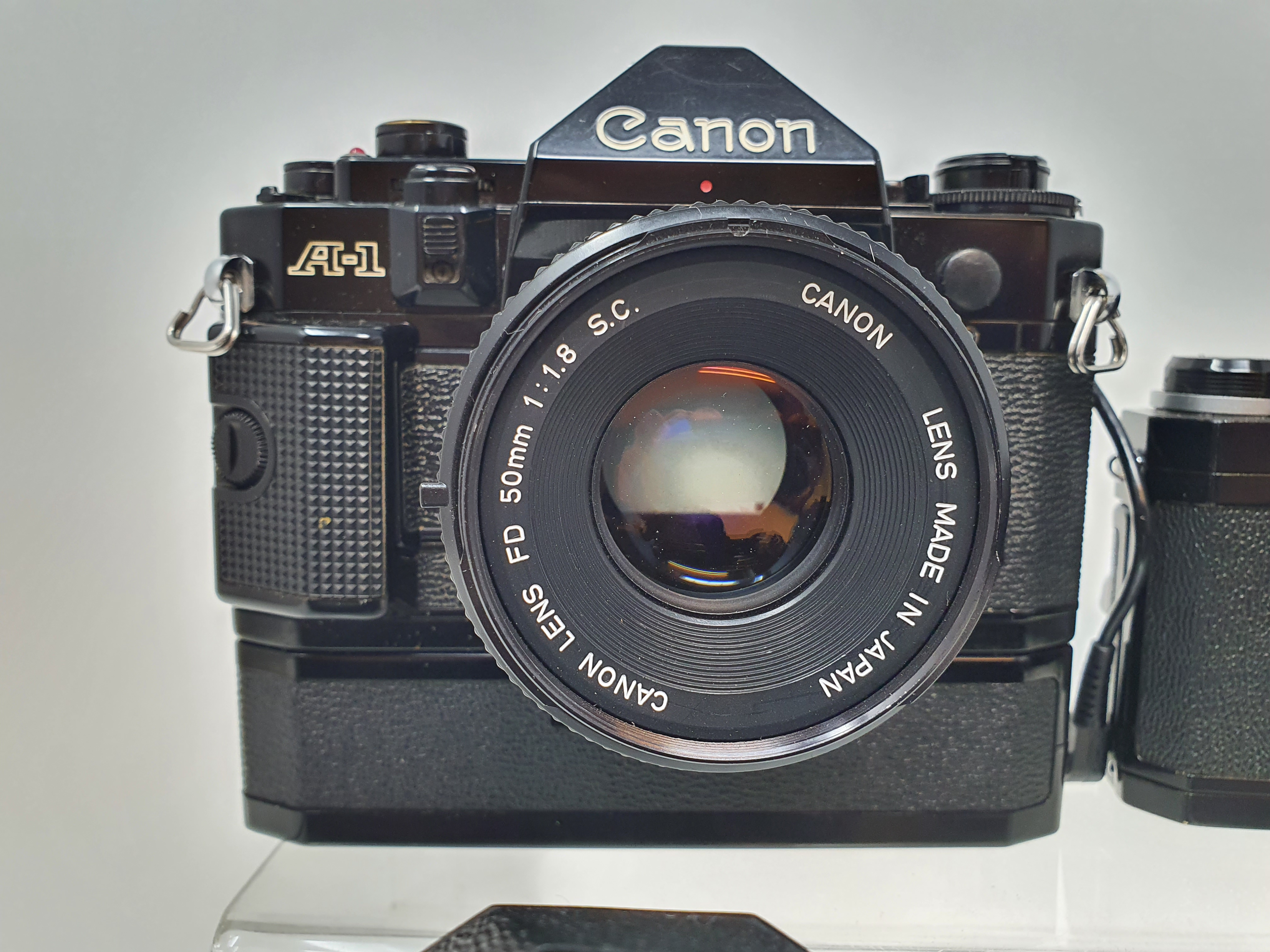 A Nikon F camera, with outer case, a Yashica GTN camera, a Canon A-1 camera, and a Nikkormat Nikon - Image 5 of 6