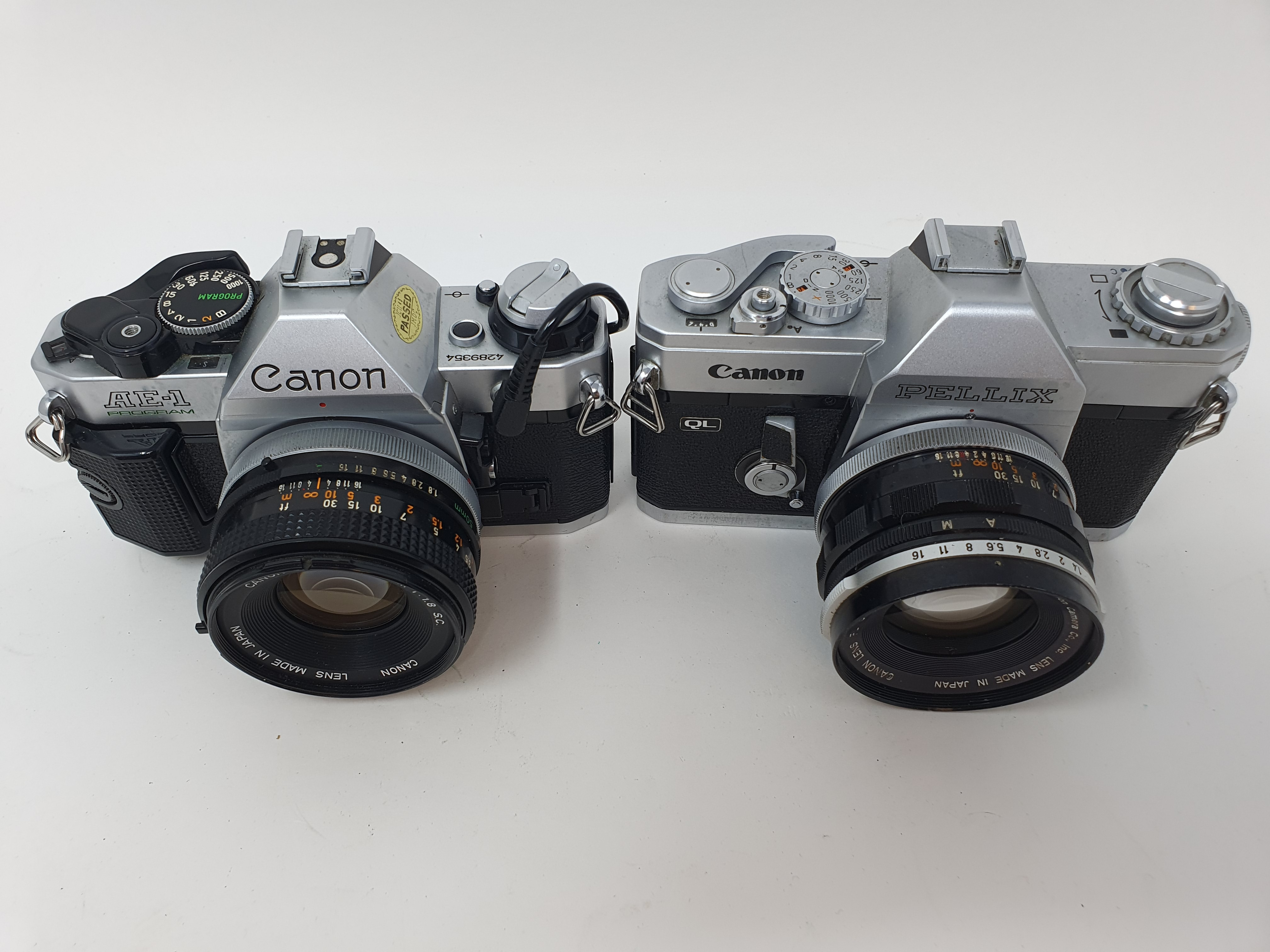 A Canon Pellix camera and a Canon AE-1 camera (2) Provenance: Part of a vast single owner collection - Image 2 of 3