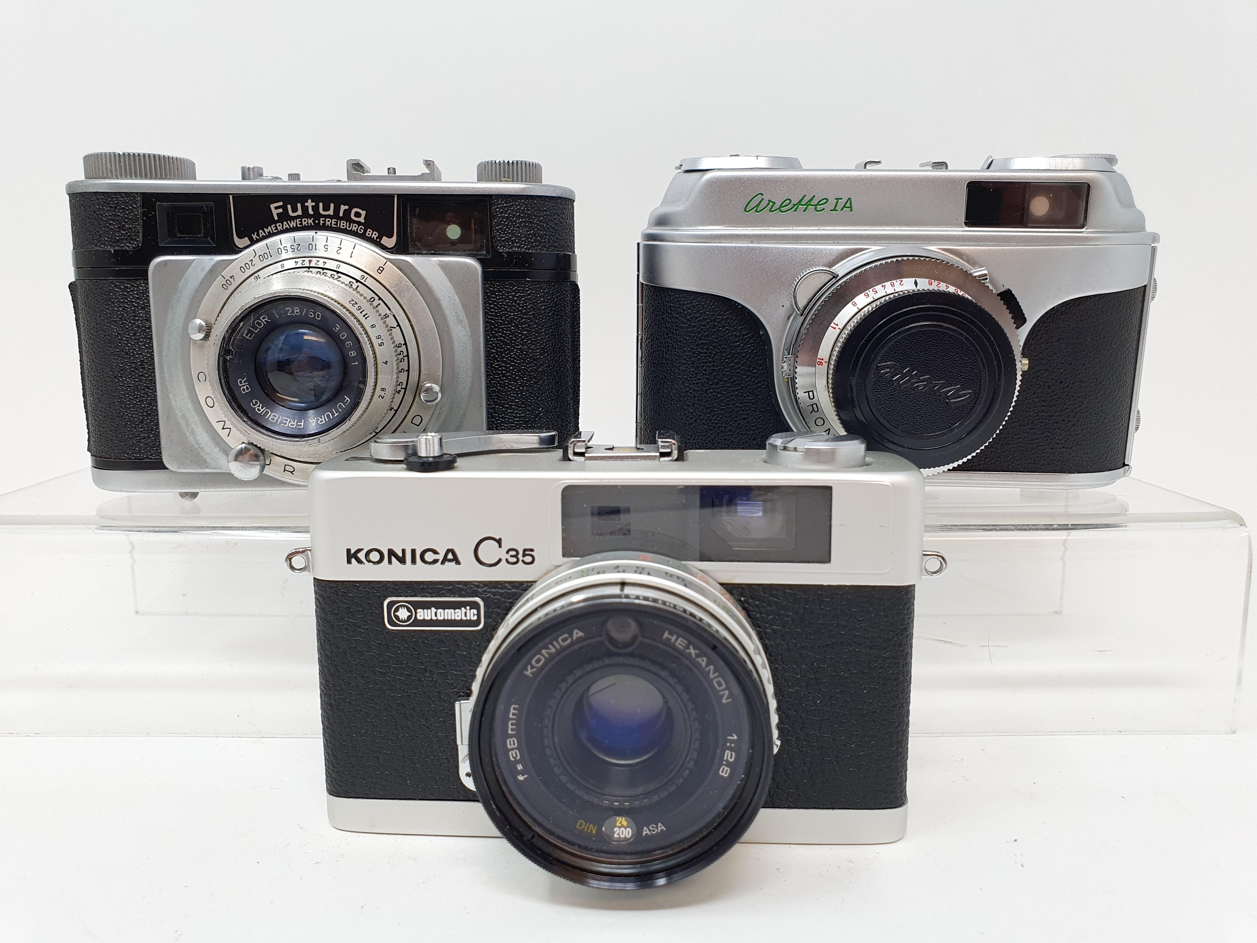 A Konica C35 camera, a Futura camera and a Arette IA camera (3) Provenance: Part of a vast single