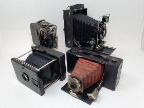 A C. P. Goerz Tenax folding camera, an Agfa folding camera, a Kodak 2 folding pocket brownie camera,