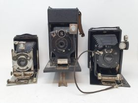 A Koilos folding camera, in leather outer case, two folding cameras and two boxes of plates (5)