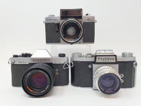 A Rolleiflex SL35 camera and a Praktica FX3 camera and a Topcom camera (3) Provenance: Part of a