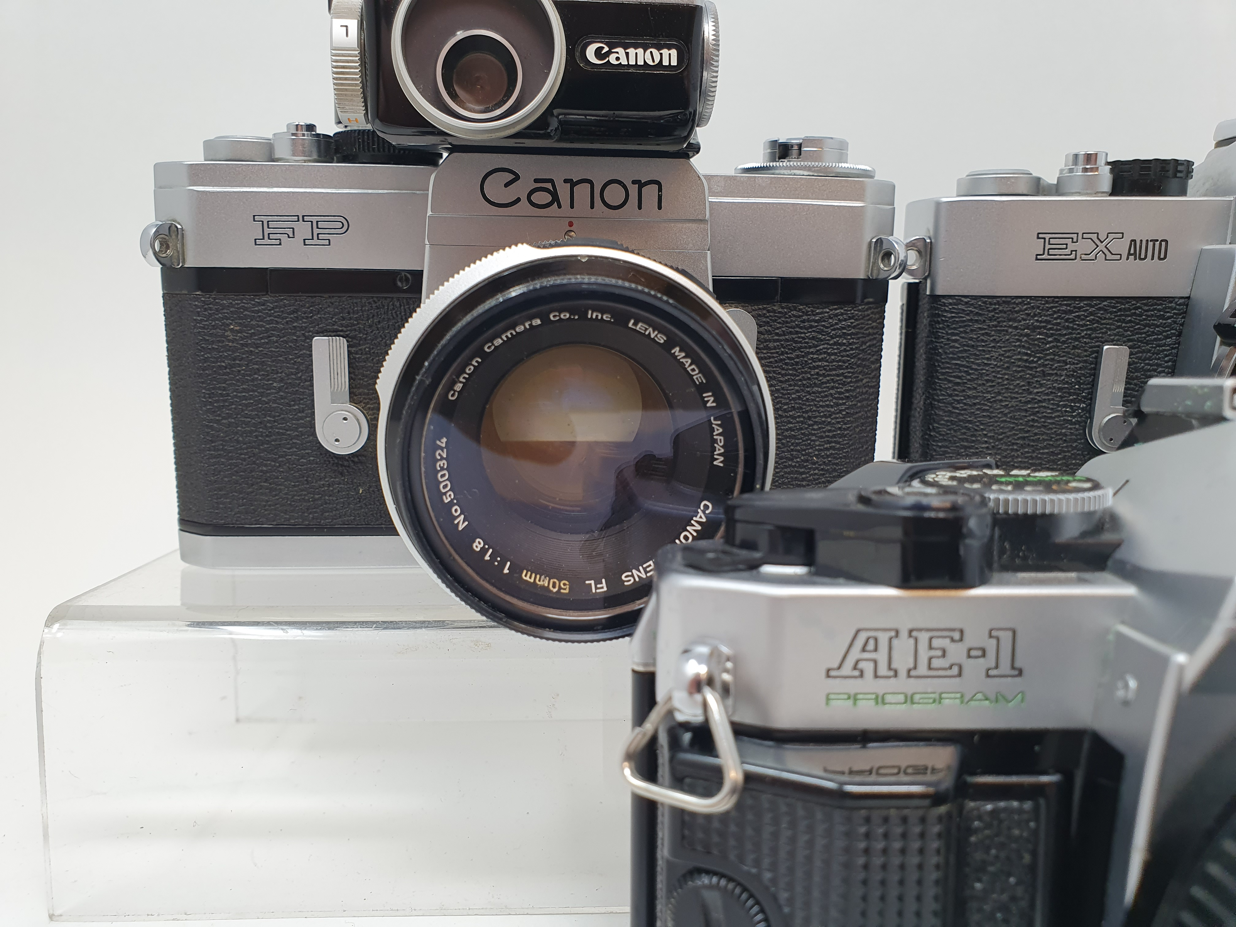 A Canon FP camera, a Canon EX Auto, and a Canon AE-1 camera (3) Provenance: Part of a vast single - Image 2 of 3