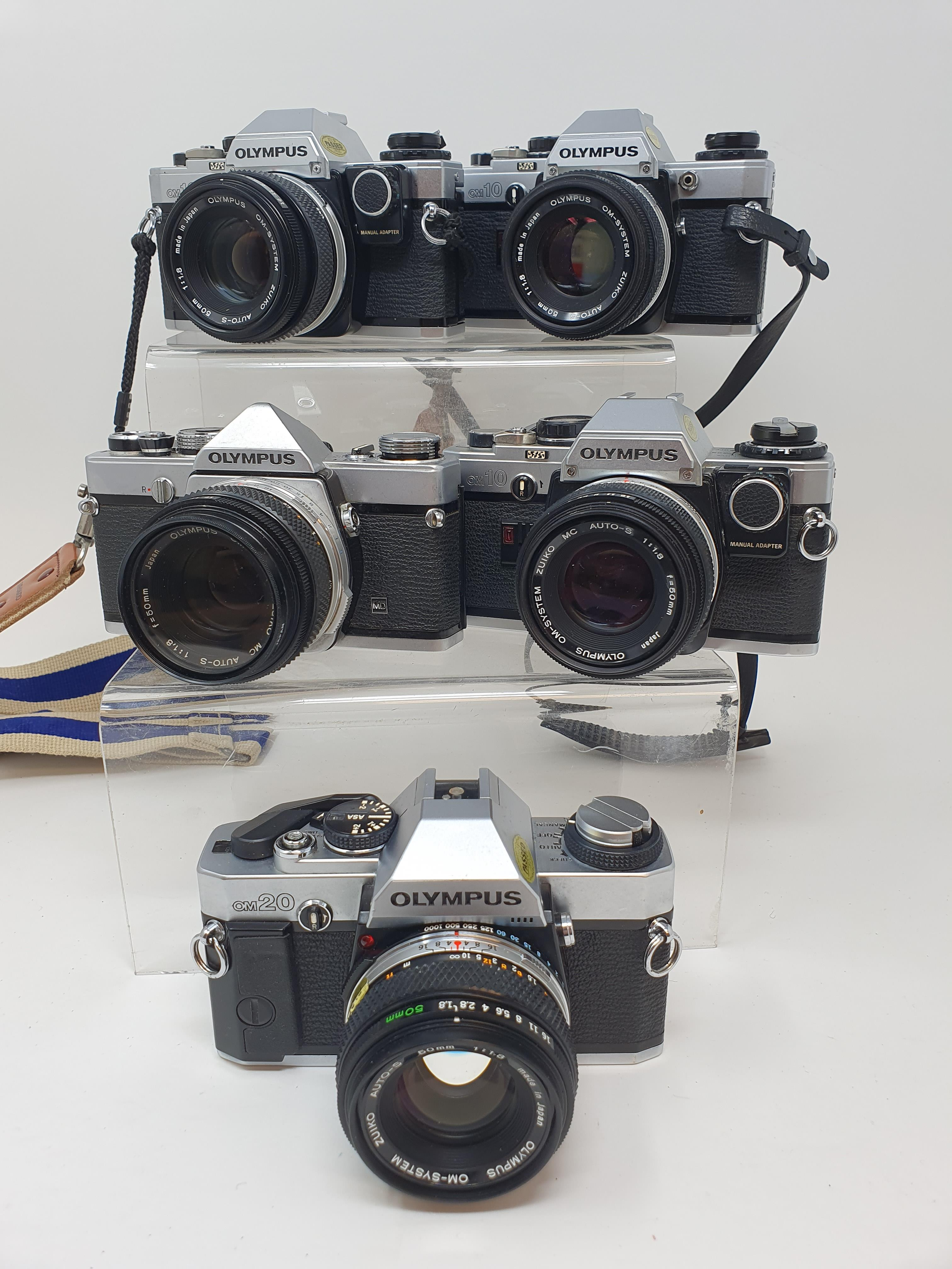 An Olympus OM-10 camera, two other OM-10s an Olympus OM-20 and an Olympus OM-1 (5) Provenance: