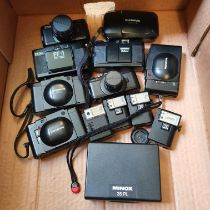 A Minox 35 PL camera, boxed, an Olympus XA Macro camera, an Olympus XA camera, an Olympus XA 1