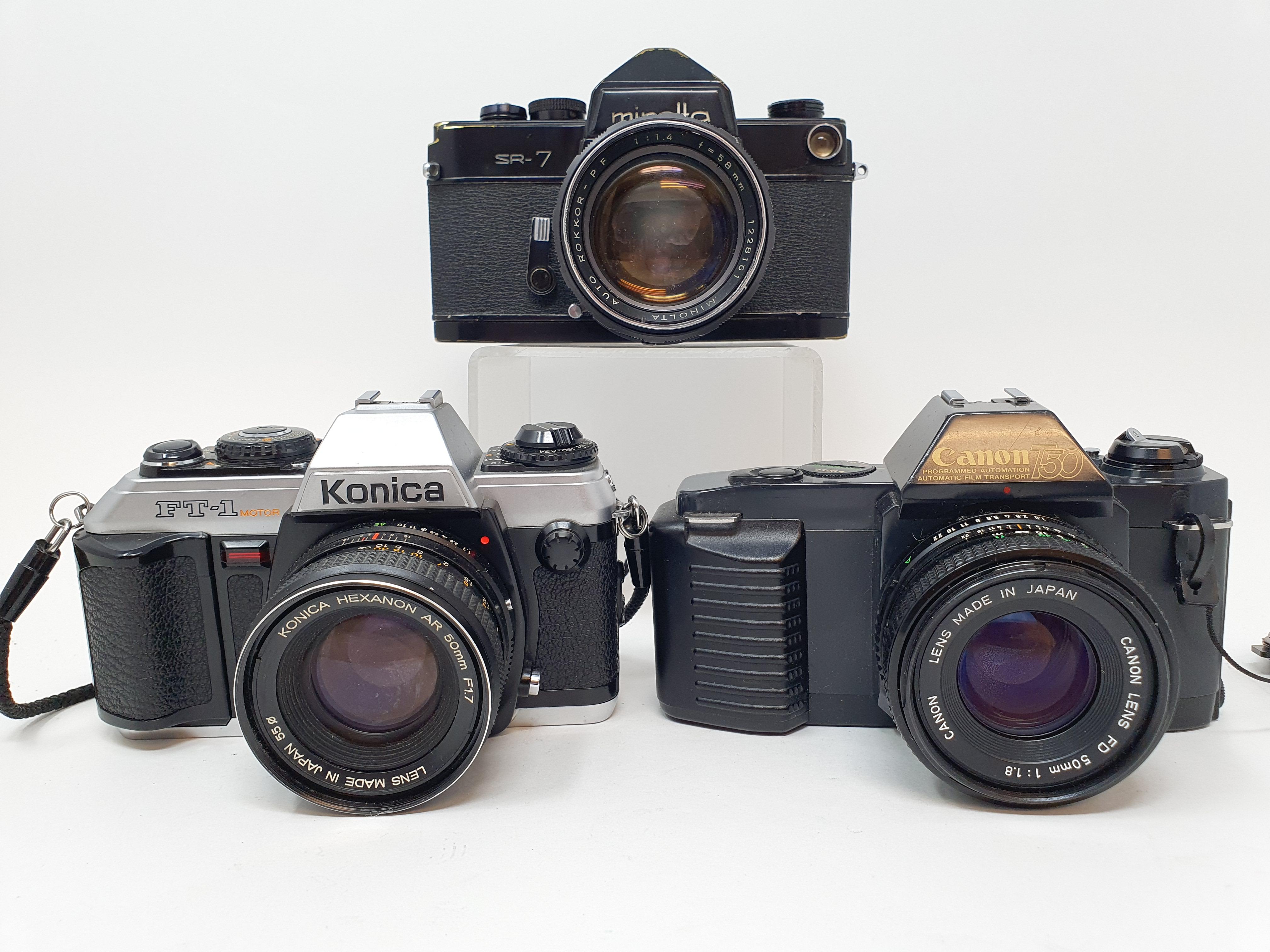 A Minolta SR-7 camera, a Canon T50 camera and a Konica FT-1 camera (3) Provenance: Part of a vast