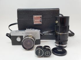An Olympus-Pen camera, serial number 129968, with extra lens and accessories, in a leather