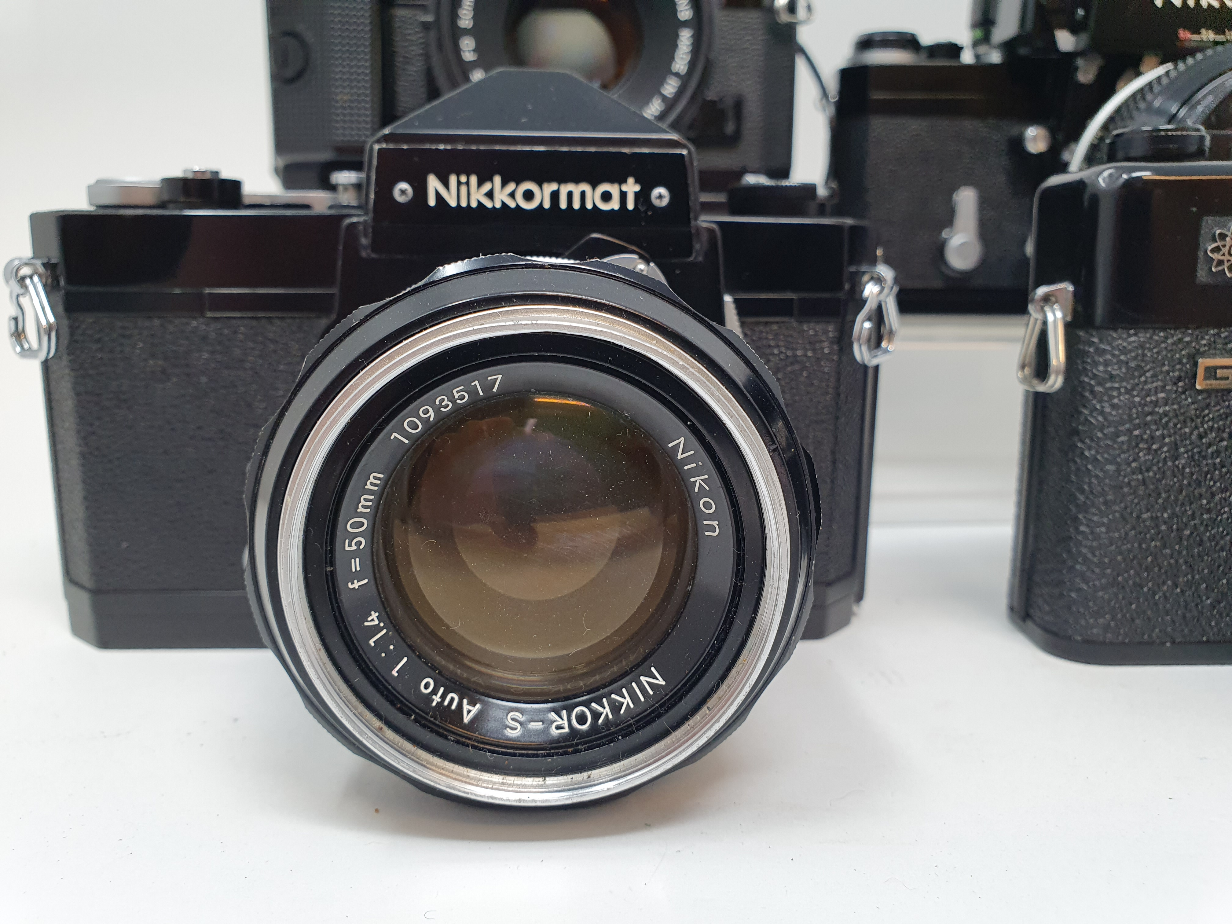 A Nikon F camera, with outer case, a Yashica GTN camera, a Canon A-1 camera, and a Nikkormat Nikon - Image 2 of 6