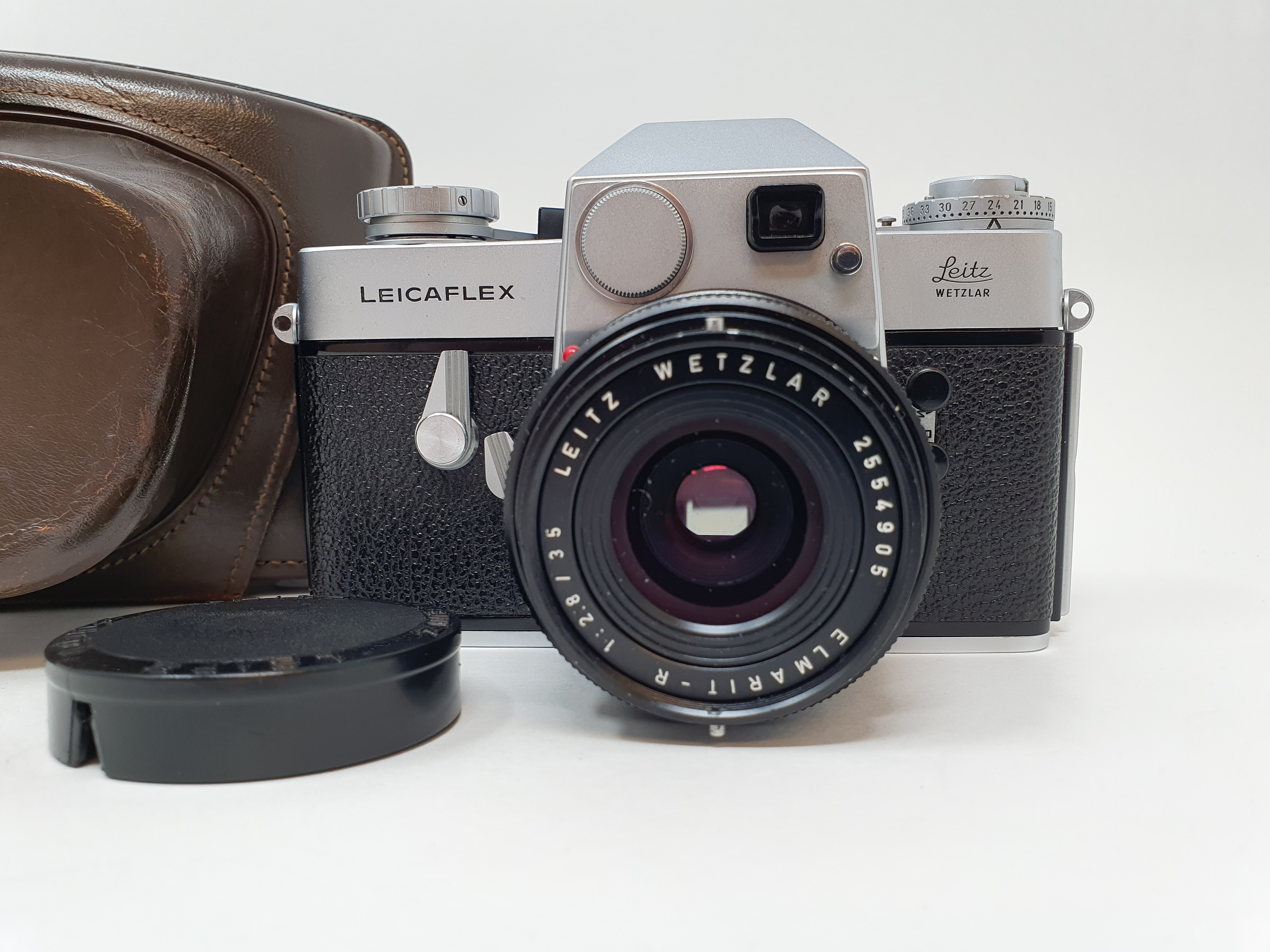A Leica Leicaflex camera, serial number 1115659, with leather outer case Provenance: Part of a