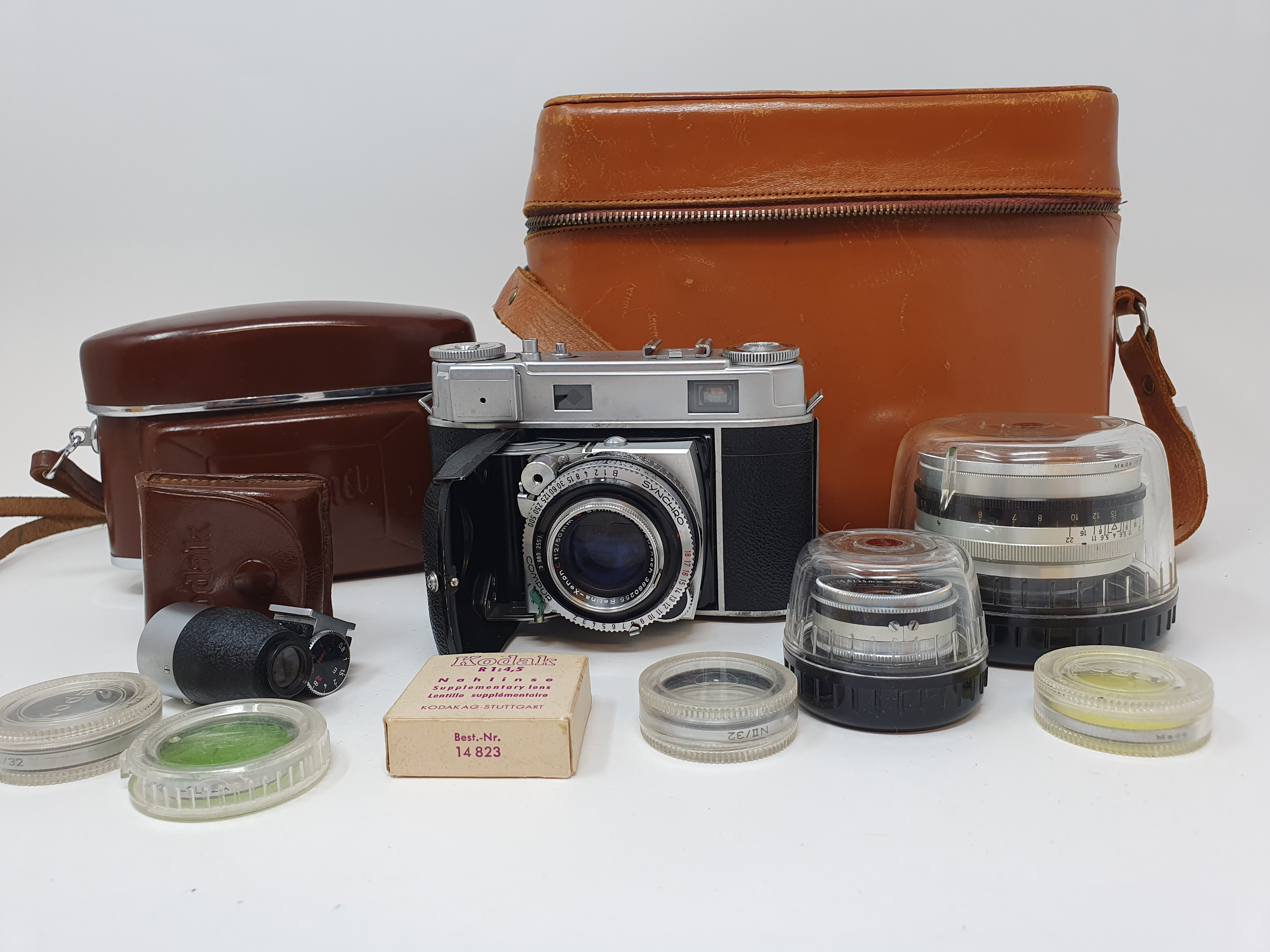 A Kodak Retina III, serial number 231293, in leather outer case, various accessories and lens, in