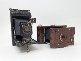 A Kodak Hawkette 2 bakelite folding camera, with outer leather case, and a Kodak folding camera,