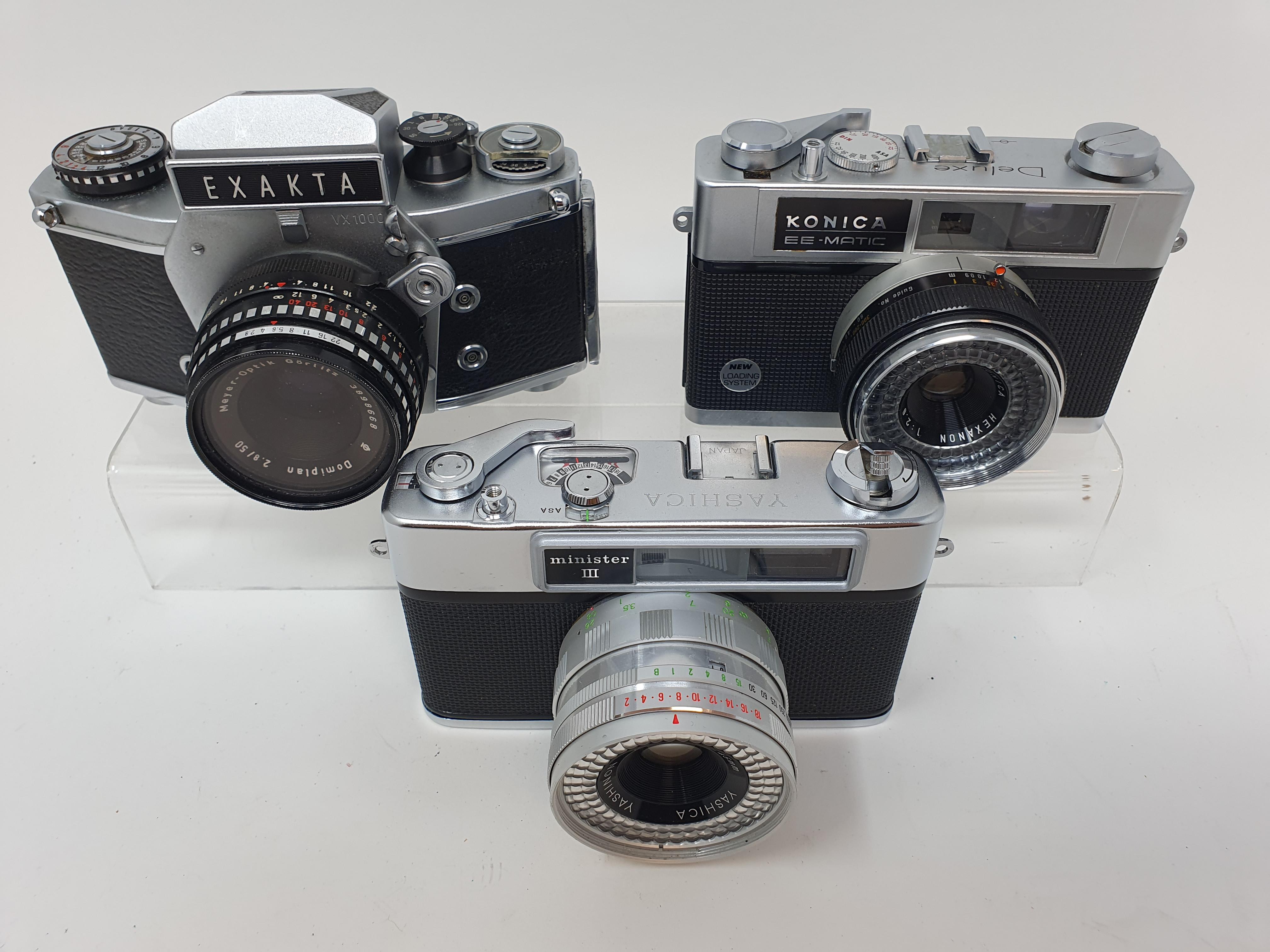 An Exakta VX 1000 camera, a Konica EE-Matic camera and a Yashica Minster III camera (3) - Image 2 of 2