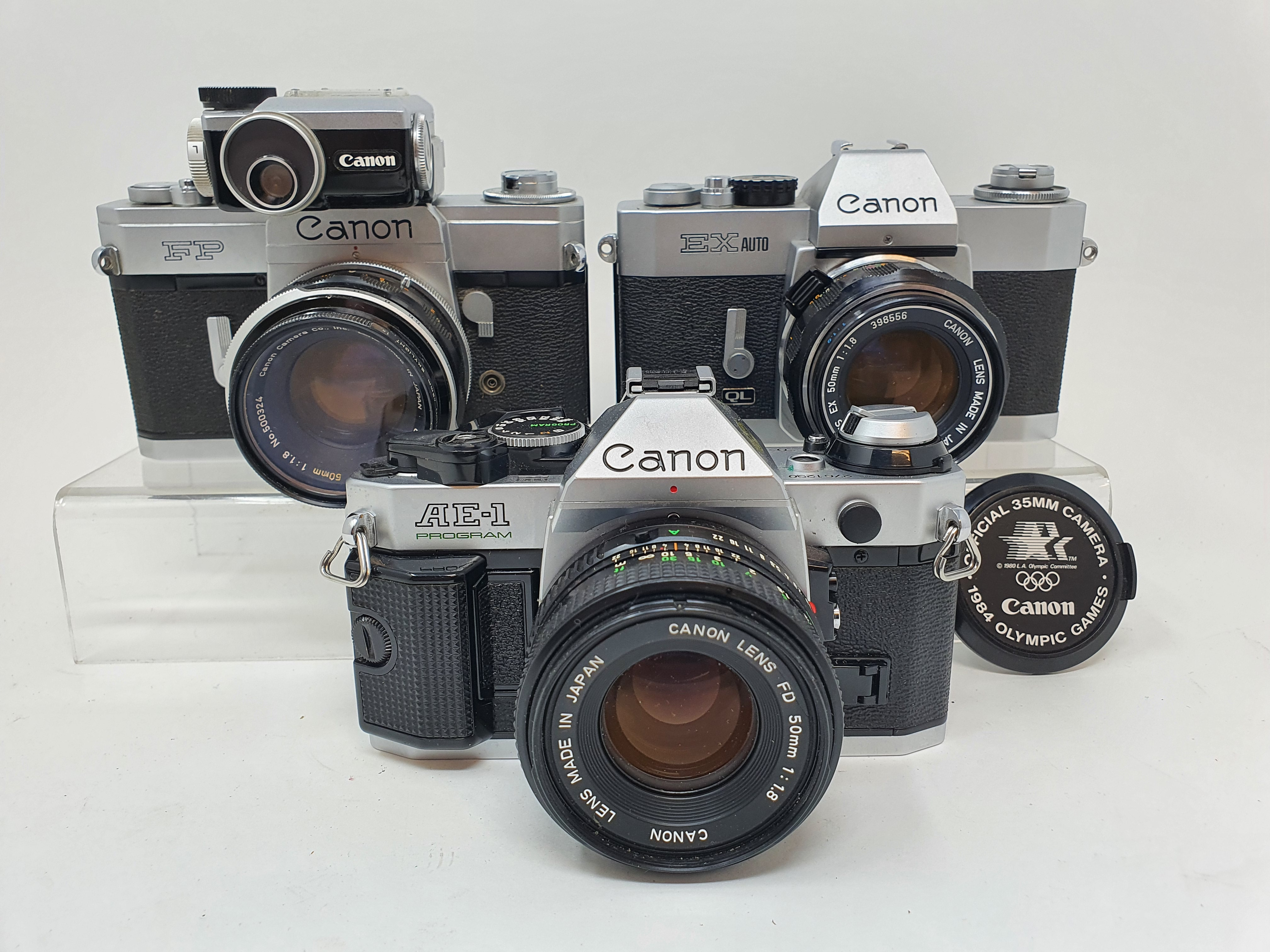 A Canon FP camera, a Canon EX Auto, and a Canon AE-1 camera (3) Provenance: Part of a vast single