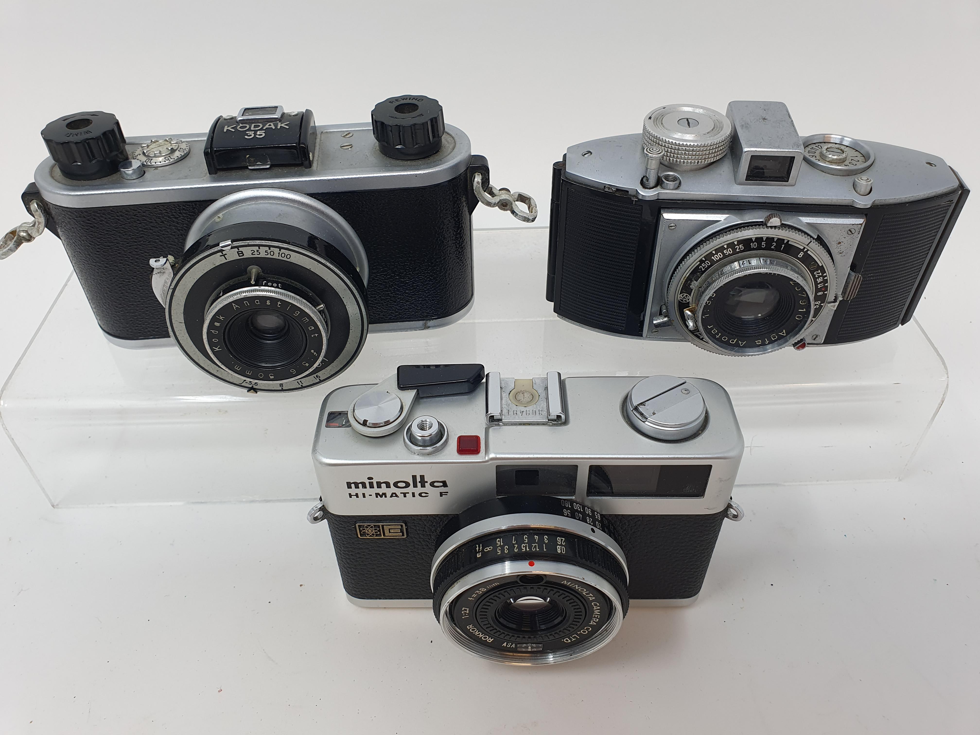 A Kodak 35 camera, a Minolta Hi - Matic F camera, and an Agfa Karat camera (3) Provenance: Part of a - Image 2 of 2