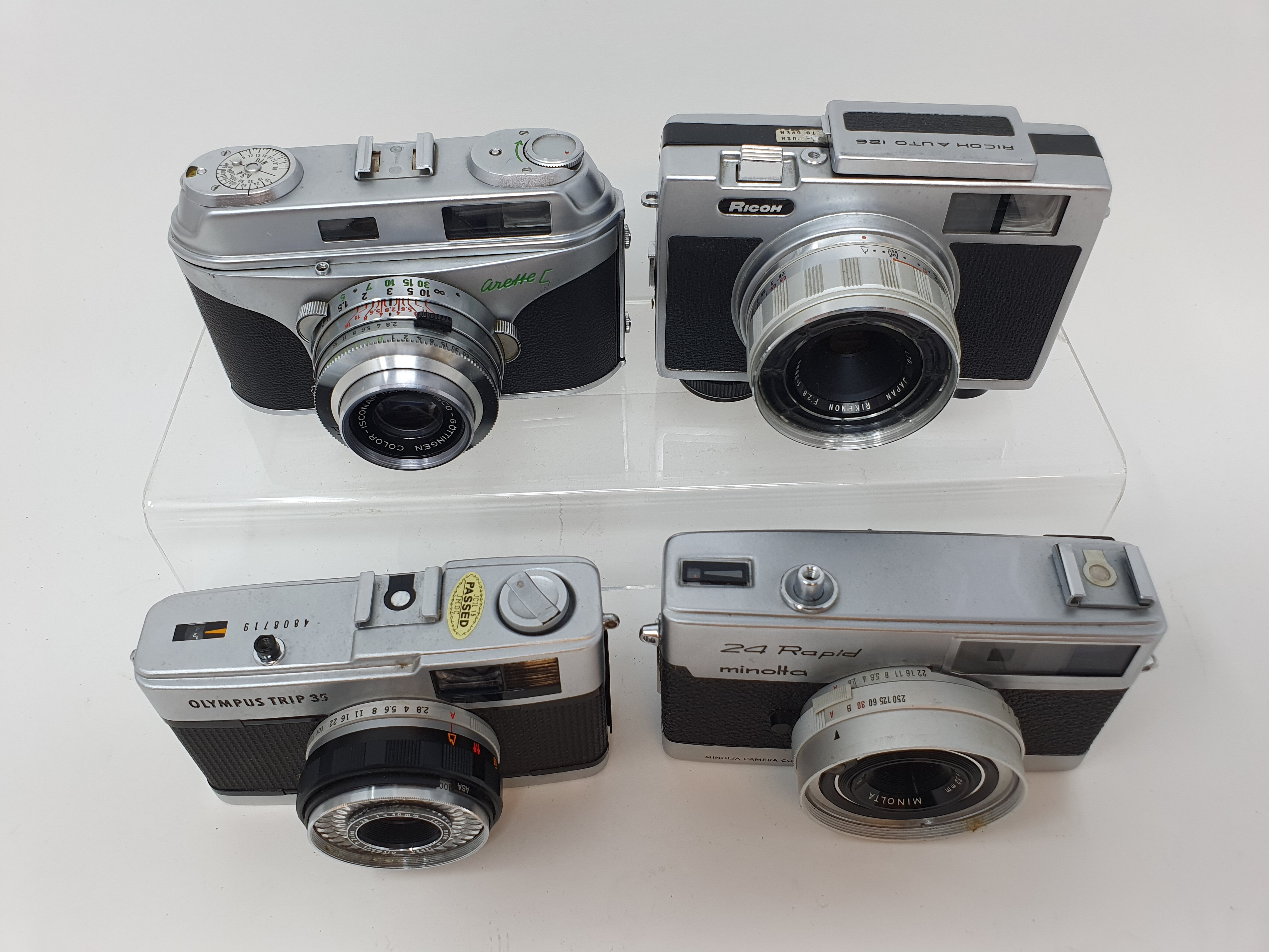A Minolta 24 Rapid camera, an Arette C camera, a Ricoh Auto 126 camera, and an Olympus Trip 35 - Image 3 of 4