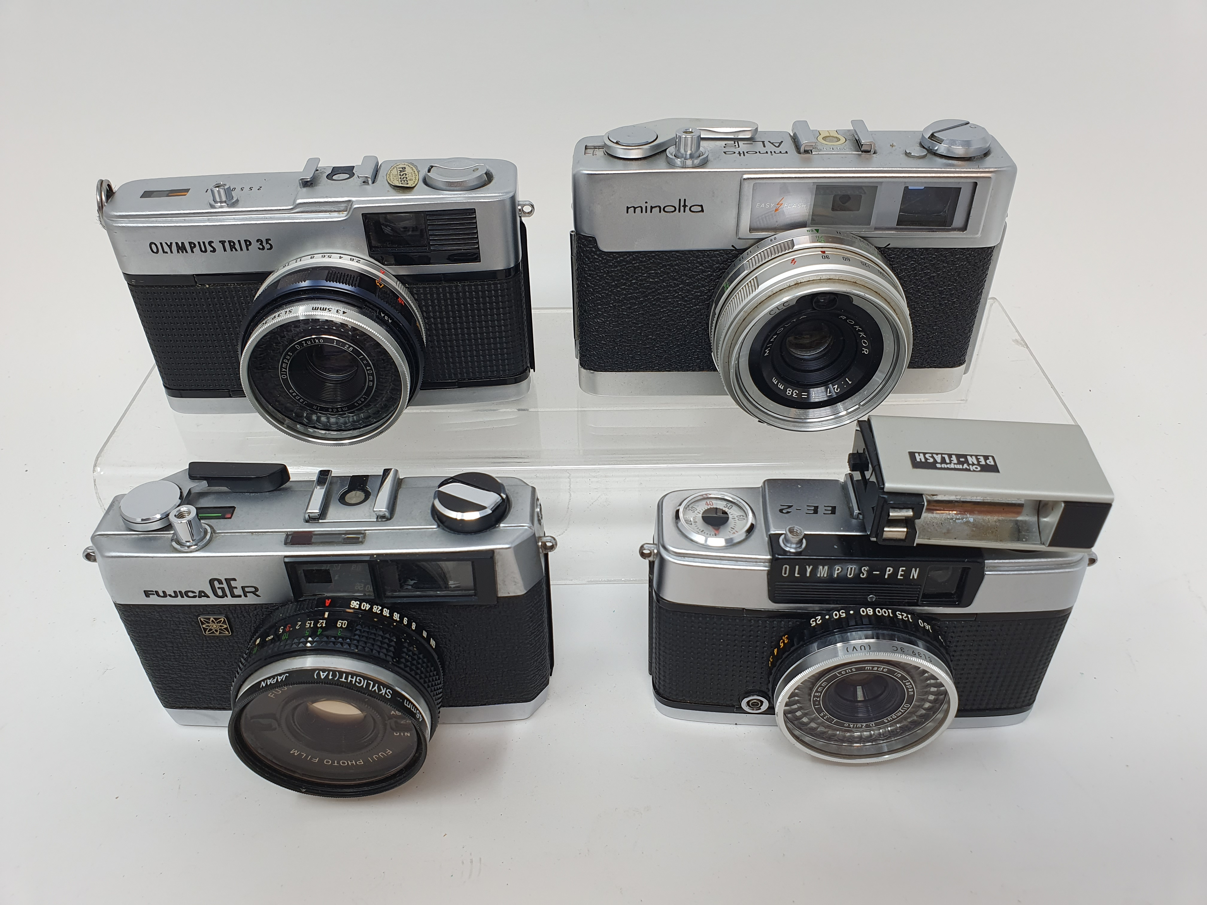 An Olympus Trip 35 camera, an Olympus - PEN camera a Fujica GER camera and a Minolta AL - F - Image 2 of 2